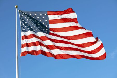 Photo of American flag waving in the wind photo