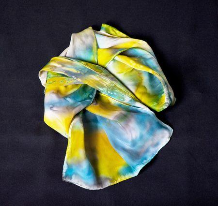 Multi coloured silk scarf on black   Stock Photo