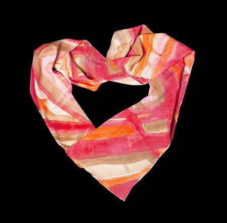 Heart made from  silk scarf on black isolated