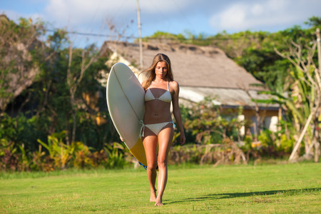 young girl with surfboard photo