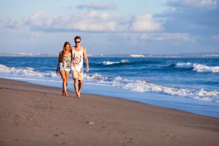 lovely couple: lovely couple walking on beach.Bali.Indonesia. Stock Photo