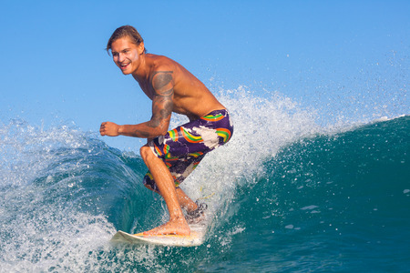 picture of surfing a wave in Indonesia. Stock Photo