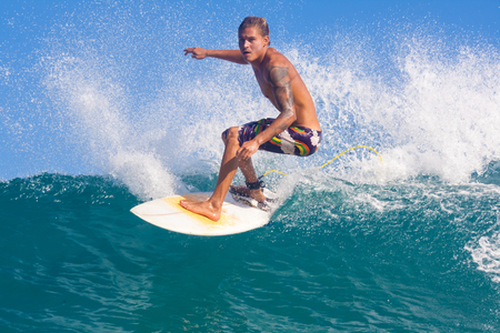 picture of surfing a wave in Indonesia. photo