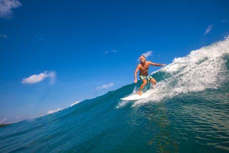 Picture of Surfing a Wave GLand Surf Area Indonesia  Stock Photo