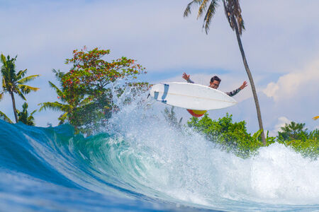 Picture of Surfing a Wave. Bali Island. Indonesia.