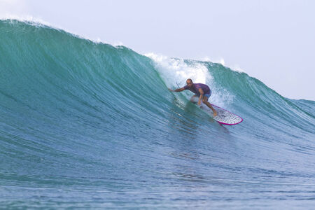 surfing a wave photo