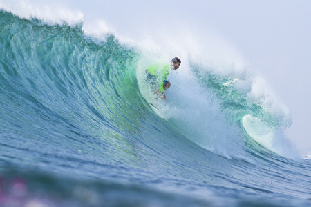 surfing a wave Stock Photo