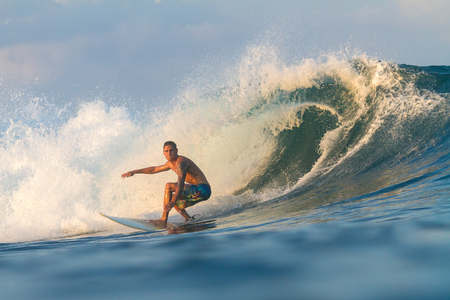 Picture of Surfing a Wave.Sumbawa Island. Indonesia. Stock Photo