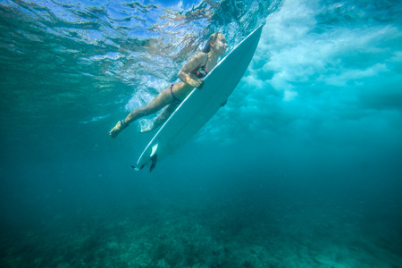 Picture of Surfing a Wave.Under Water Picture. Stock Photo