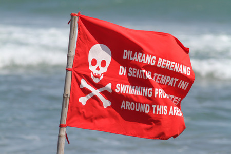 no swimming sign: Red Flag on the Sand Beach with No Swimming Sign . Stock Photo