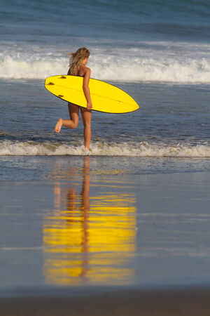 Picture of surfer girl.Bali. Indonesia. photo