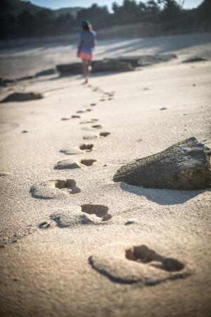 Woman Walks Alone on a Deserted Beach. Lombok Island. Indonesia. Stock Photo