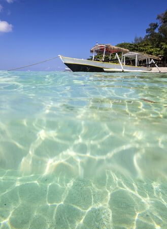Long Tail Boat on Tropical Beach photo