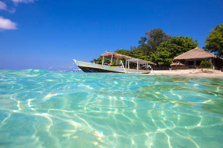long tail: Long Tail Boat on Tropical Beach Stock Photo