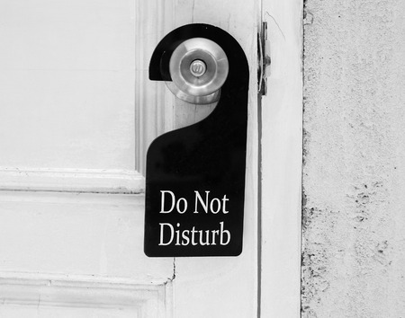 door sign: Do not disturb sign hang on door knob Stock Photo