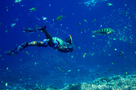 Young Man Snorkeling in the Tropical Water of Indian Ocean.