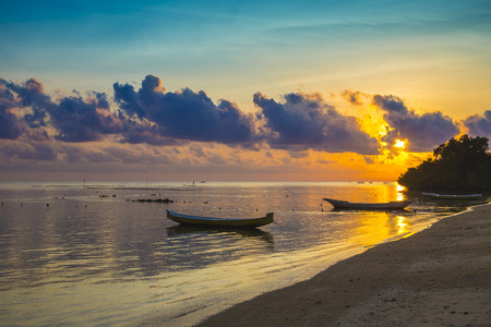 long tailed boat: Sunset scene of  fisherman long tailed boat in Bali, Indonesia. Stock Photo