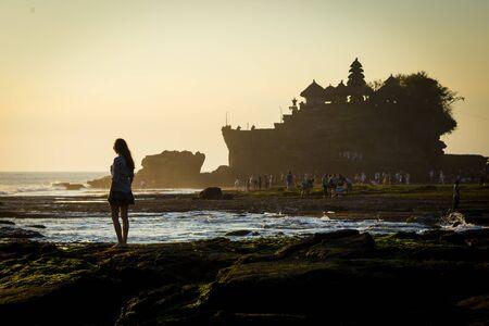sea cliff: sunset over hindu temple Pura Tanah Lot, Bali, Indonesia Stock Photo