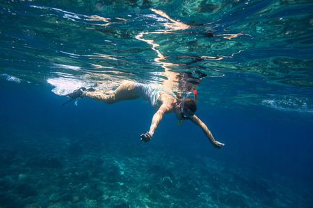 el sheikh: Young Women Snorkeling in the Tropical Water of Indian Ocean.