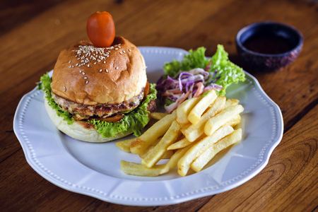 Delicious burger with beef, tomato, cheese and lettuce.