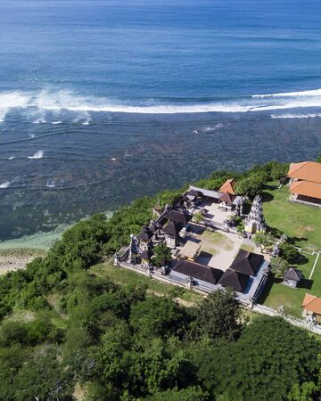 Aerial view of Balinese temple at coastline Stock Photo