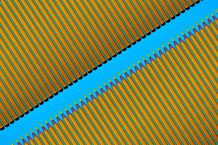 Pattern of yellow pencils at blue background
