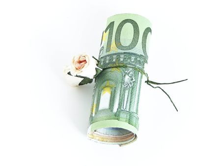 denominations: Rose as present with money Stock Photo
