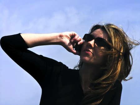 beautifu: Woman outdoor on phone talking... Stock Photo