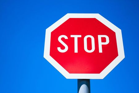 Stop sign in contrast with blue sky... photo