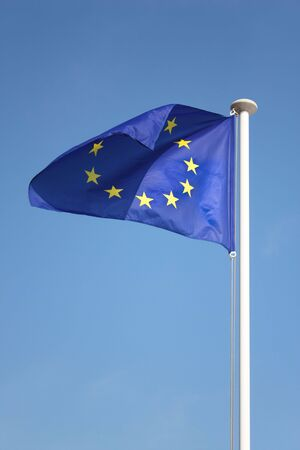 European Union flag against blue sky photo