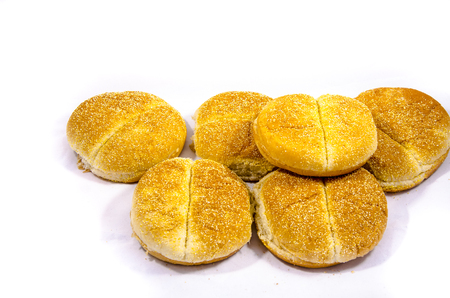 Bread is a staple food prepared from a dough of flour and water, usually by baking.