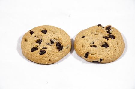 A cookie is a baked or cooked food that is small, flat and sweet.