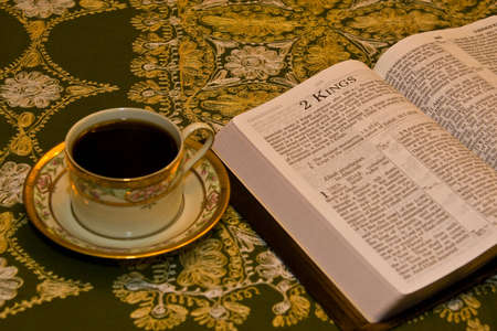 Bible Open on dining room table with coffee Imagens - 4364611