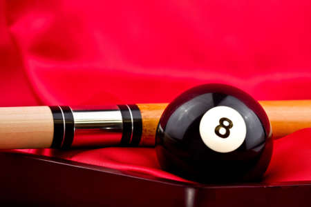 Eight Ball and Cue Stick