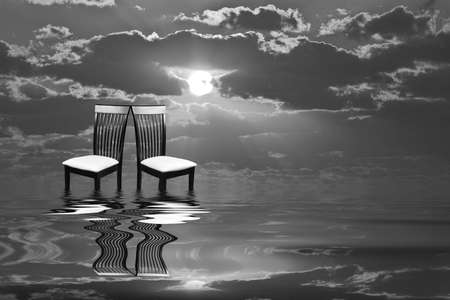 dreary: Abstract print of chairs standing alone in waters Stock Photo