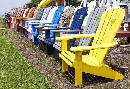Lineup Of Colorful Outside Lawn Wooden Lawn Chairs For Sale On Roadside  Stock Photo   4952924