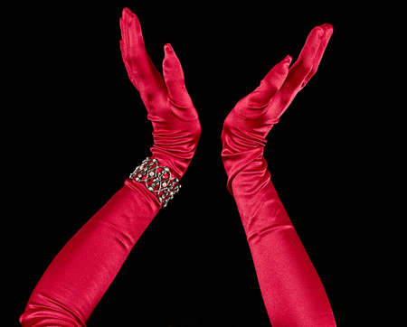 Red silk formal long length gloves with decorative bracelet with black background