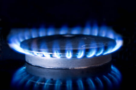 stovetop: Flame furning on gas stove