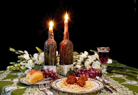 Romantic Italian dinner talbe set for spaghetti and meatballs