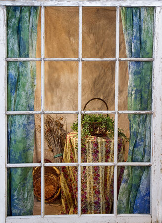 Old weather-beaten window pane - view of inside of home from outside looking in