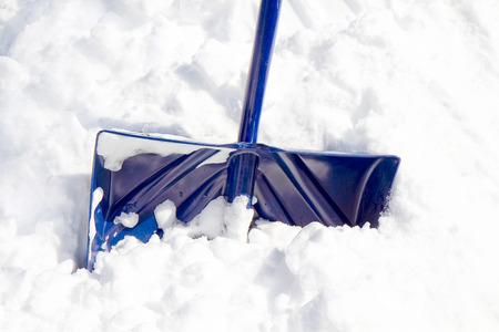Blue Snow Shovel in snow