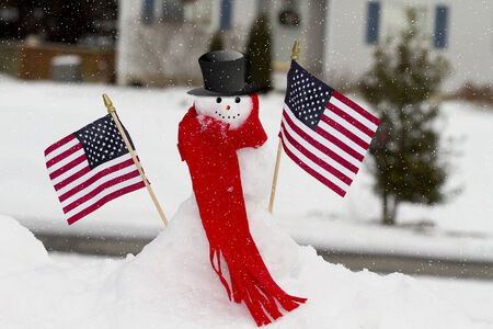 Patriotic snowman holding USA flags Imagens