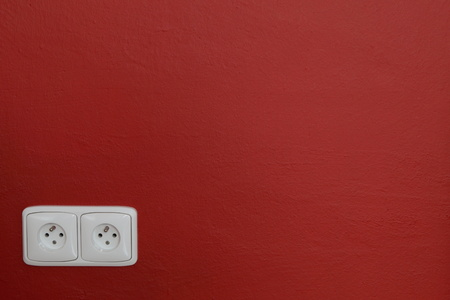 ampere: Wall outlets on the red wall