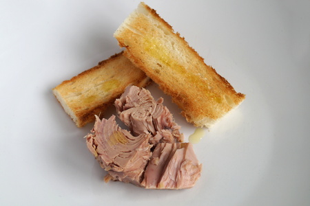 tunafish: Tuna steak with olive oil and toast Stock Photo