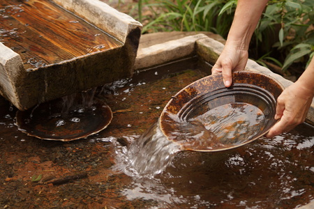 gold rush: Panning for gold with pan and sluice Stock Photo
