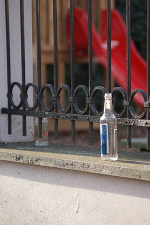 cirrhosis: Empty bottles of alcohol lays in near of children�s playground