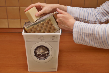 parer: Woman shredding soap to make his own laundry detergent