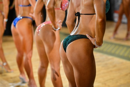 Fitness bikini competition, side view of female buttocks. Banco de Imagens