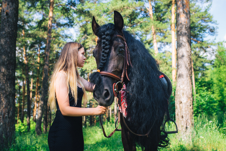 beautiful woodland: Young beautiful girl with a horse in woodland.
