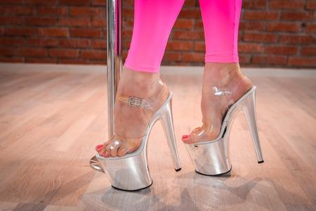 strip tease: Woman shoes for pole dance closeup.